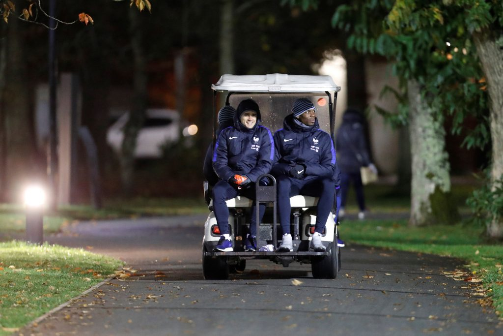 France's Antoine Griezmann and Paul Pogba attends training.