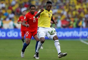 Colombia's Yerry Mina (R) and Chile's Jean Beausejour compete for the ball.