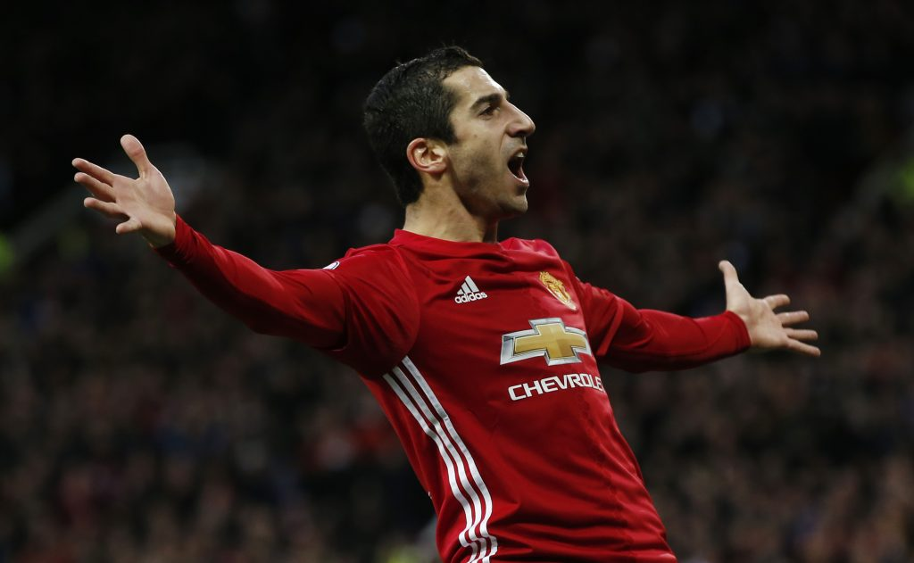 Manchester United's Henrikh Mkhitaryan celebrates scoring their first goal.