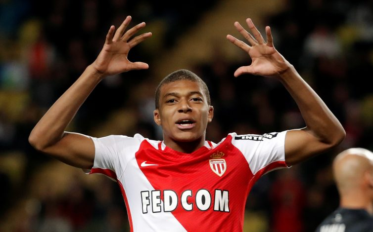 Monaco's Kylian Mbappe reacts after missing a goal.