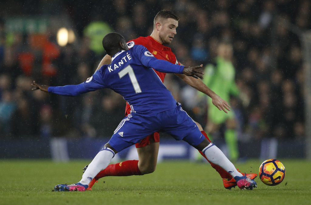 Liverpool's Jordan Henderson in action with Chelsea's N'Golo Kante.