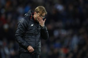 Liverpool manager Klopp looks dejected.