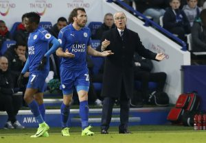 Leicester City manager Claudio Ranieri and Christian Fuchs react.