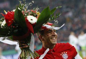 Bayern Munich's Philipp Lahm receives flowers before his match against VFL Wolfsburg.
