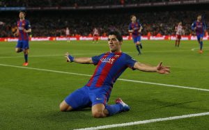 Barcelona's Luis Suarez celebrates after scoring their first goal.