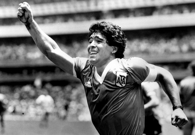 Argentinian star Diego Maradona raises his arm in the air after scoring his game winning goal against England.