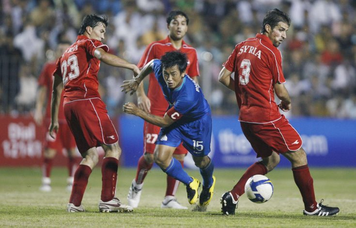 India's captain Bhaichung Bhutia (C) fights for the ball.