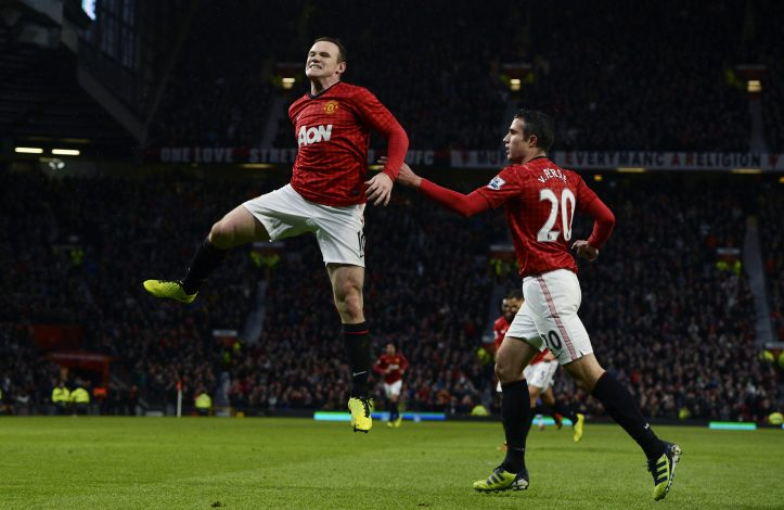 Manchester United's Wayne Rooney (L) celebrates with Robin van Persie.