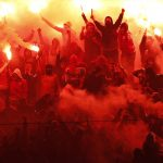 Galatasaray fans light flares to celebrate their goal against Fenerbahce.