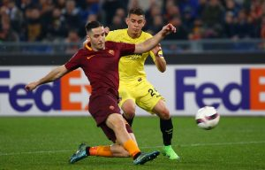 Roma's Kostas Manolas in action with Villarreal's Santos Borre.