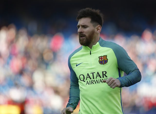 Barcelona's Lionel Messi warms up before the match.