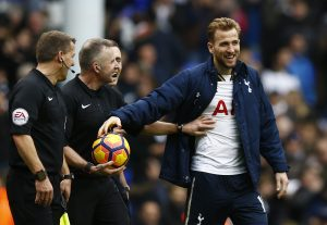 Harry Kane takes the match ball from referee Jonathan Moss at the end of the match after completing a hat trick.