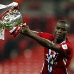 Manchester United's Eric Bailly celebrates with the trophy after winning the EFL Cup Final.