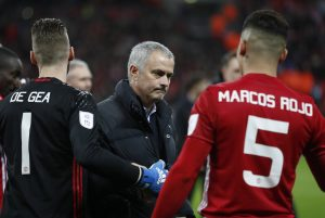 Manchester United manager Jose Mourinho with David De Gea and Marcos Rojo at the end of the match.