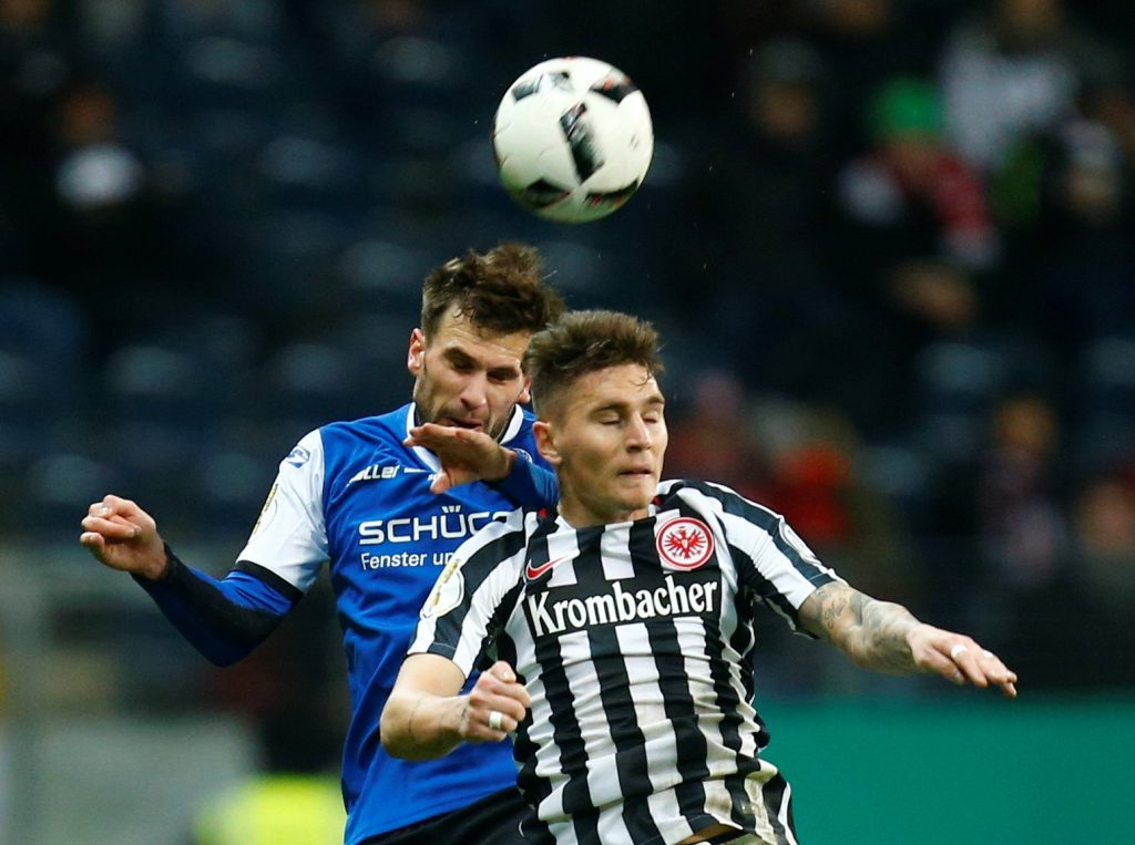 Eintracht's Guillermo Varela and Bielefeld's Christopher Noethe in action.