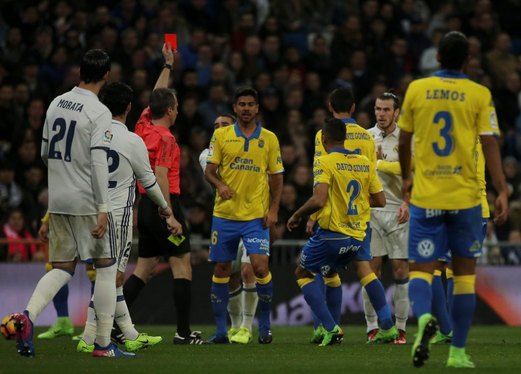 Real Madrid's Gareth Bale (2nd R) is sent off by the referee.