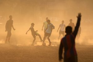 Boys fight for the ball during their soccer practice at a park in Mumbai, India.