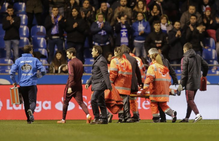 Paramedics carry Atletico Madrid's Fernando Torres on a stretcher to a waiting ambulance after he suffered a head injury during the match.
