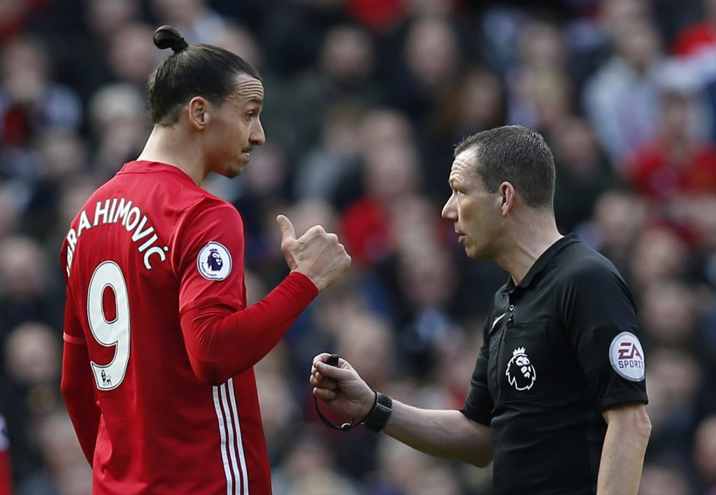 Zlatan Ibrahimovic speaks with referee Kevin Friend.