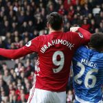 Bournemouth's Tyrone Mings is challenged by Manchester United's Zlatan Ibrahimovic.