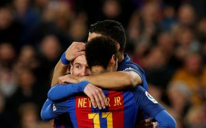 Lionel Messi, Neymar and Luis Suarez celebrate a goal.