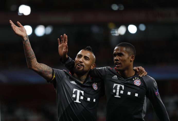 Bayern Munich's Arturo Vidal celebrates scoring their fifth goal with Douglas Costa.