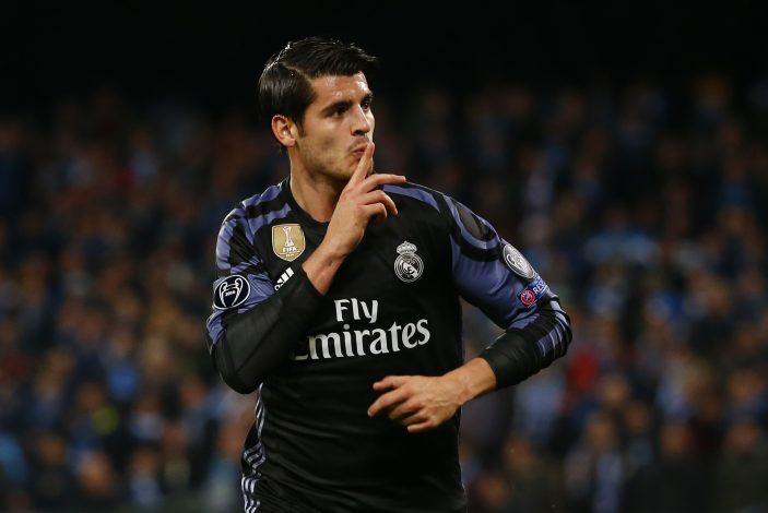 Real Madrid's Alvaro Morata celebrates scoring their third goal.