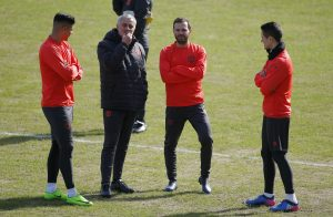 Manchester United coach Jose Mourinho with Juan Mata, Marcos Rojo and Ander Herrera during training.