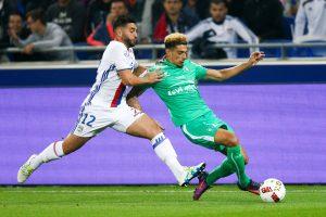 Olympique Lyon's Jordan Ferri (L) in action against St Etienne's Kevin Malcuit.