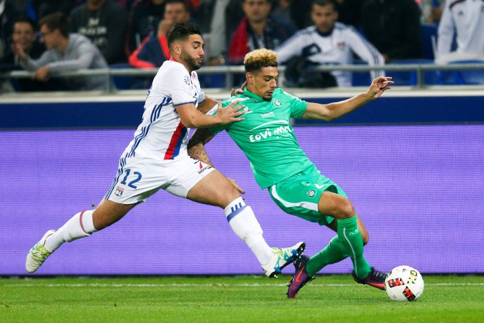 Olympique Lyon's Jordan Ferri (L) in action against St Etienne's Kevin Malcuit.