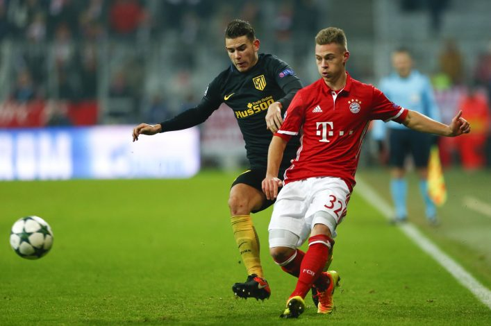Bayern Munich's Joshua Kimmich in action with Atletico Lucas Hernandez.