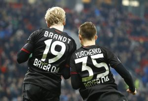 Bayer 04 Leverkusen's Julian Brandt and Vladlen Yurchenko react.