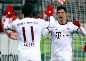 Bayern Munich's Robert Lewandowski and Douglas Costa celebrate a goal against Freiburg.