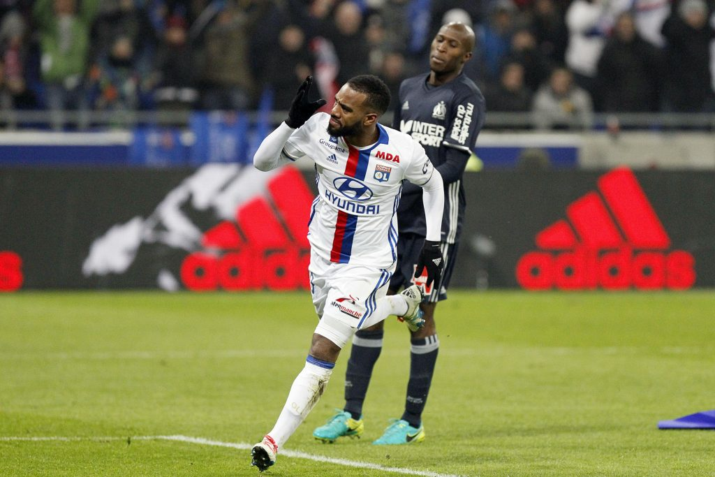 Alexandre Lacazette celebrates his goal for Olympique Lyon.