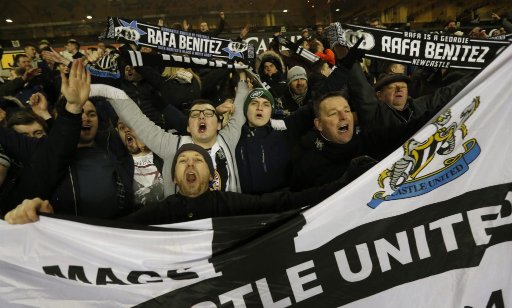 Newcastle United fans celebrate after the game.