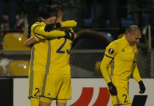 Rostov's Sardar Azmoun celebrates with his team mates after scoring a goal.