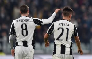 Juventus' Paulo Dybala is congratulated by his team mate Claudio Marchisio.