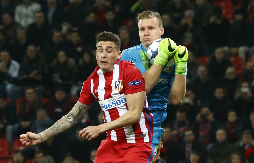 Atletico Madrid's Jose Gimenez in action with Bayer Leverkusen's Bernd Leno.