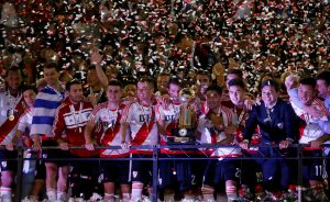 River Plate's players celebrate with the trophy after winning the match.