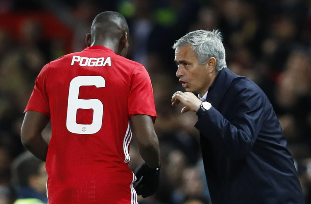 Manchester United manager Jose Mourinho with Manchester United's Paul Pogba.
