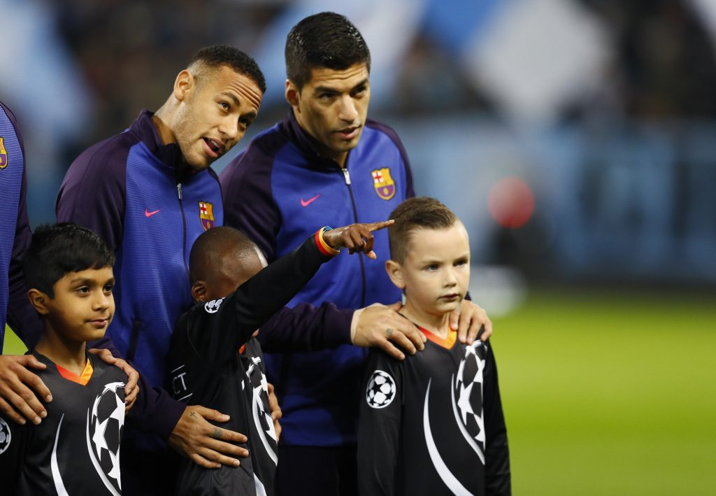 Barcelona's Neymar and Luis Suarez with mascots before the match.