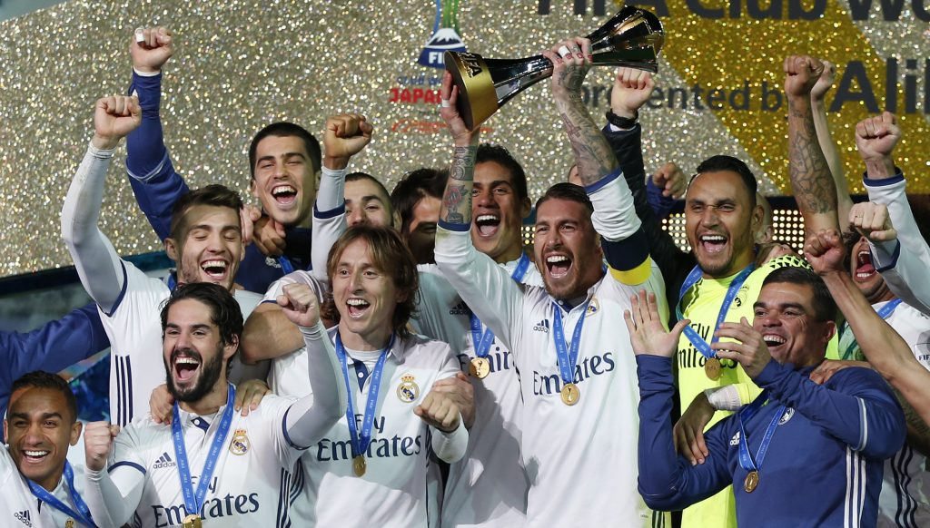 Sergio Ramos and team mates celebrate winning the FIFA Club World Cup Final with the trophy.