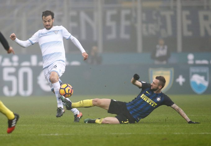 Inter Milan's Marcelo Brozovic (R) and Lazio's Marco Parolo fight for the ball.