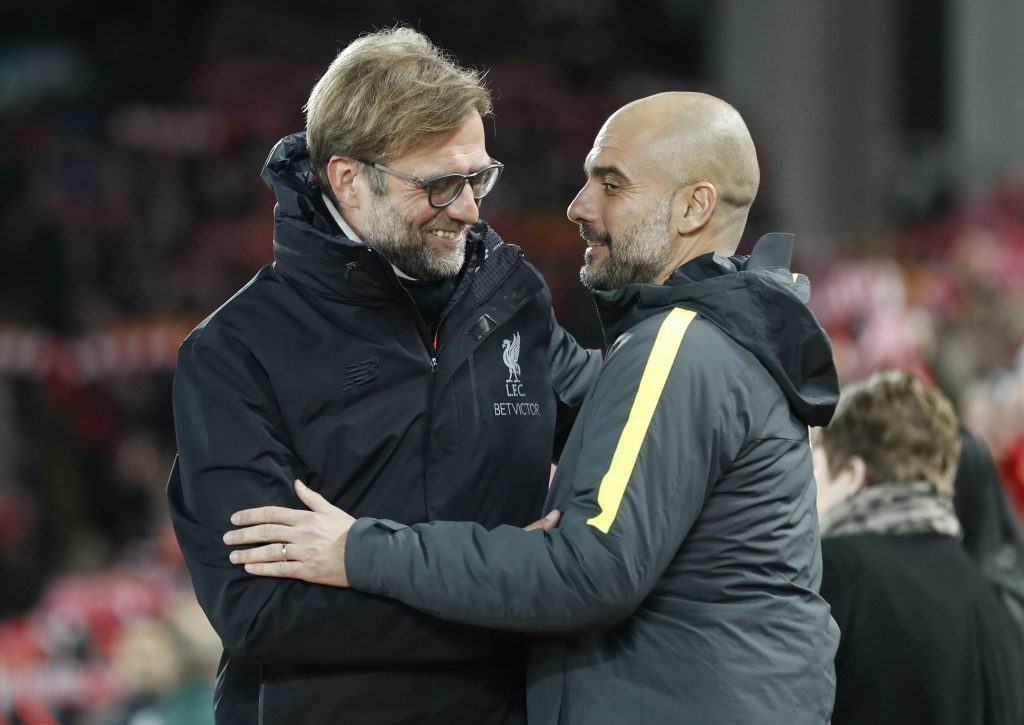 Manchester City manager Pep Guardiola with Liverpool manager Jurgen Klopp before the match.