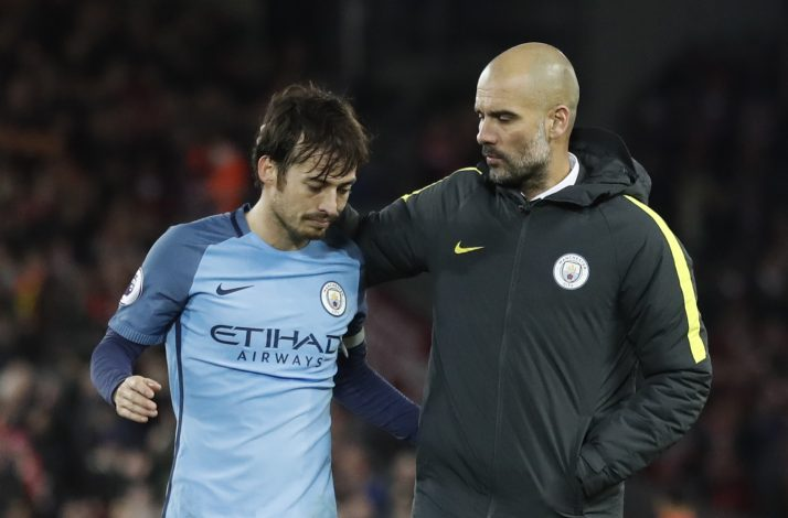 Manchester City's David Silva and Manchester City manager Pep Guardiola after the game.