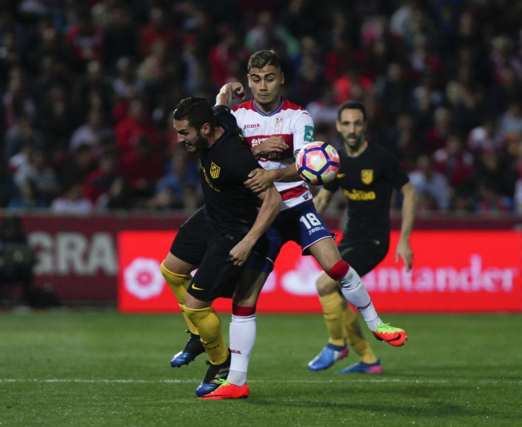 "Atletico Madrid's Jorge ""Koke"" Resurrecion and Granada's Andreas Pereira in action."