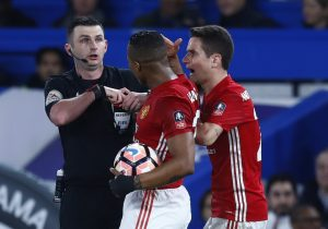 Manchester United's Ander Herrera is shown a red card by referee Michael Oliver.
