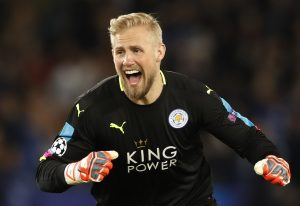 Leicester City's Kasper Schmeichel celebrates after Wes Morgan scores their first goal.