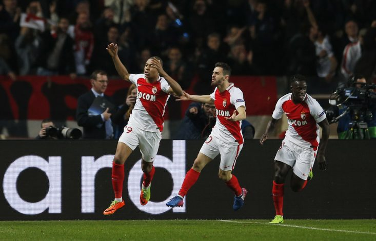 Monaco's Kylian Mbappe-Lottin celebrates with Bernardo Silva and Benjamin Mendy.