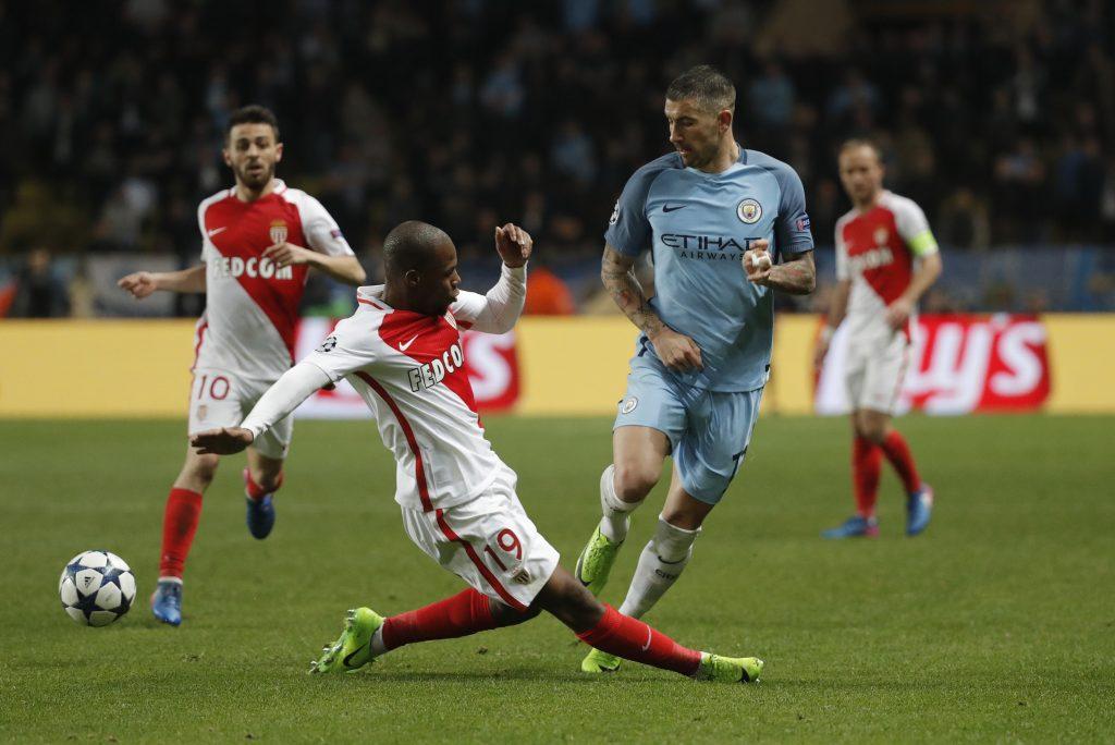 Manchester City's Aleksandar Kolarov in action with Monaco's Djibril Sidibe.